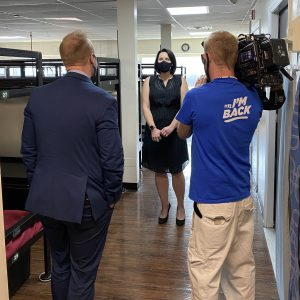 Open Doors executive director Michele Conderino and News12 team in emergency shelter dorm
